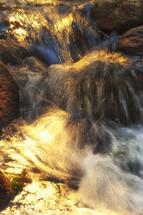 water over rushing rocks