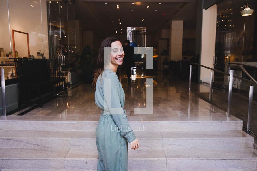 smiling woman looking back at the camera