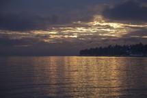 Colorful sunset lighting up a lake.