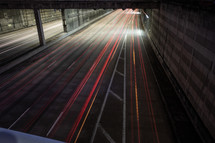 streaks from taillights on a road