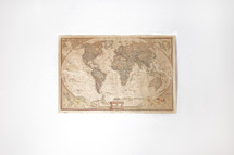 a world map hanging on a wall