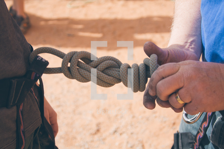 tying a knot for scaling rocks, rock climbing