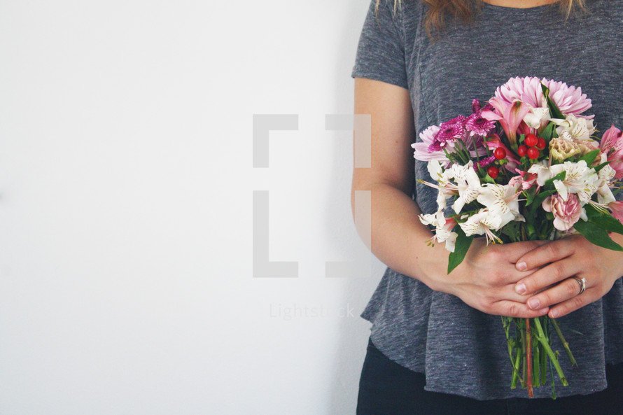 female holding a bouquet of flowers