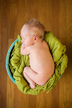 naked newborn in a basket