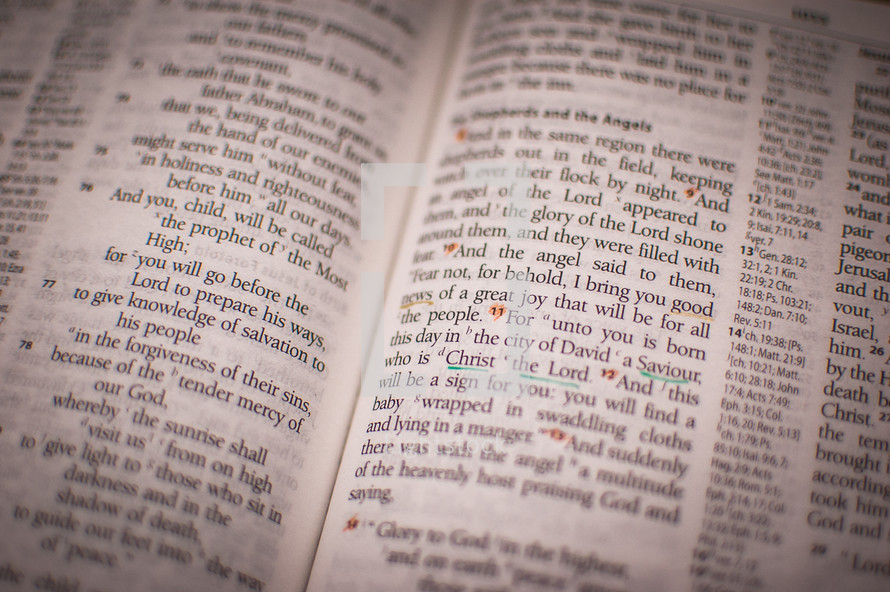 Bible  opened to text from the Gospel of Luke chapter 2, the story of the Shepherds and the angels, with the words 'Good news', 'Saviour' and 'Christ the Lord' underlined.