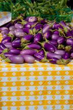 Eggplant and okra on a picnic table.