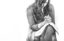 Praying women with open bible