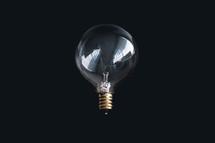 lightbulb in darkness