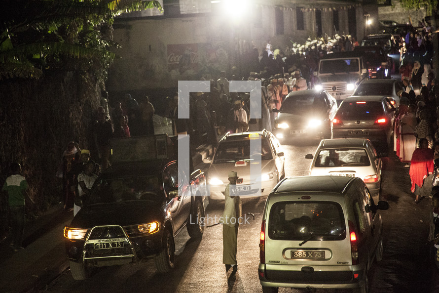 cars at night on a busy African street