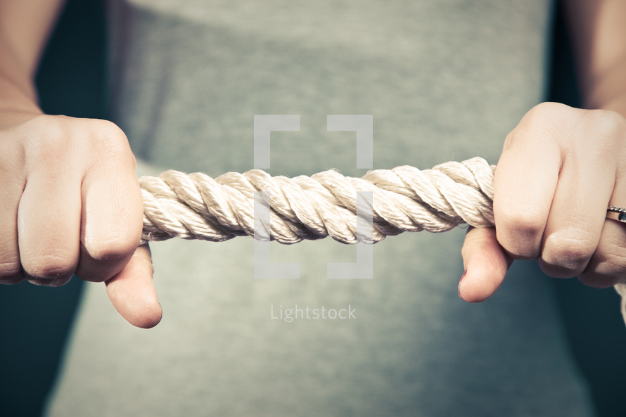 holding onto a thick rope