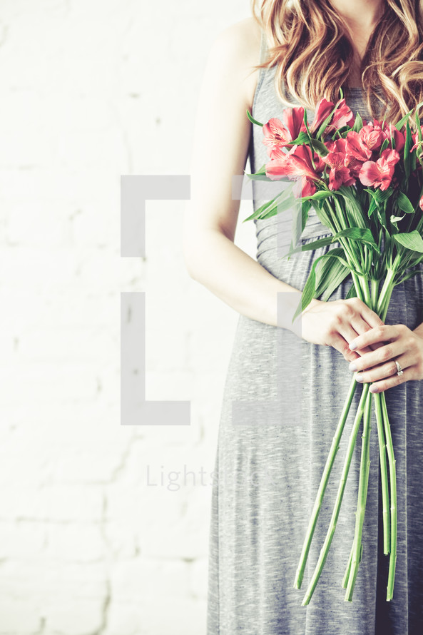 mother holding a bouquet of flowers