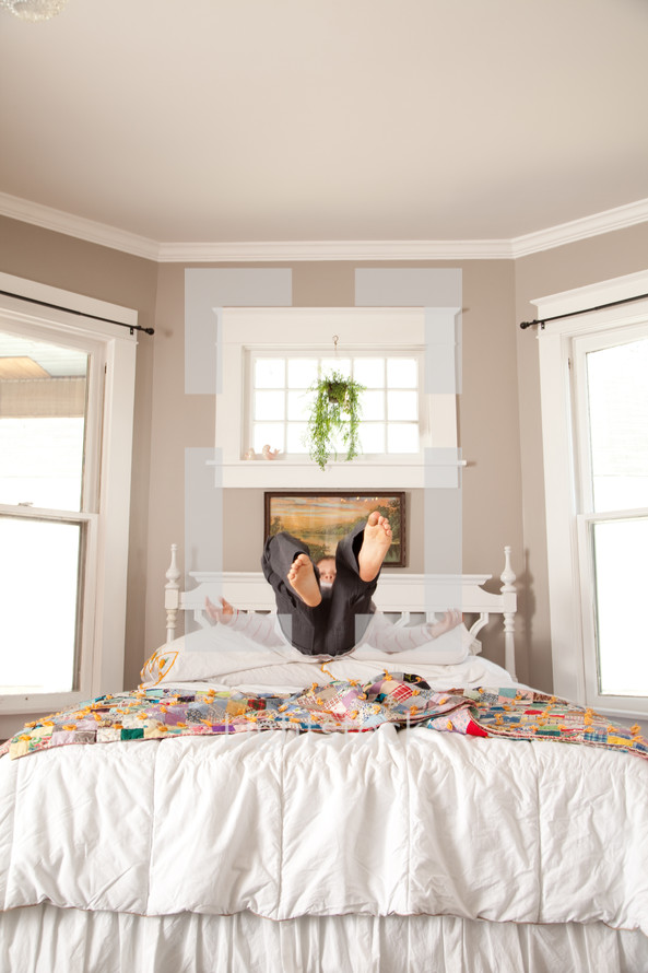 a child falling onto a bed