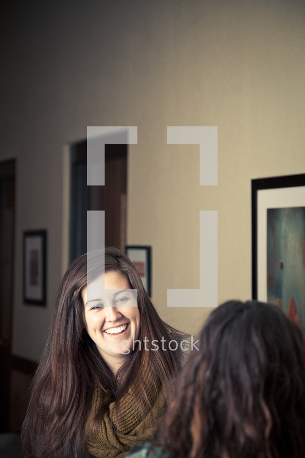 Two women laughtin and smiling.