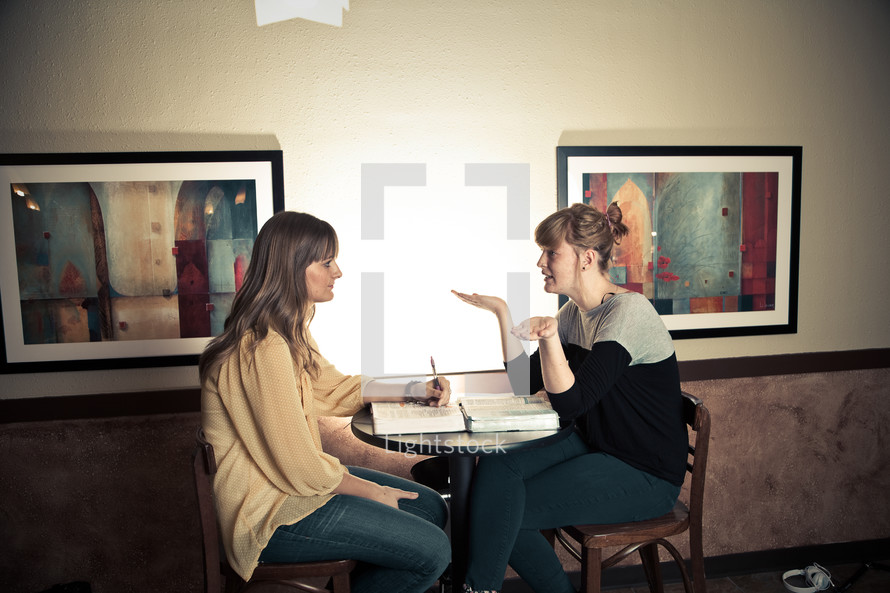 two women discussing scripture at a Bible study