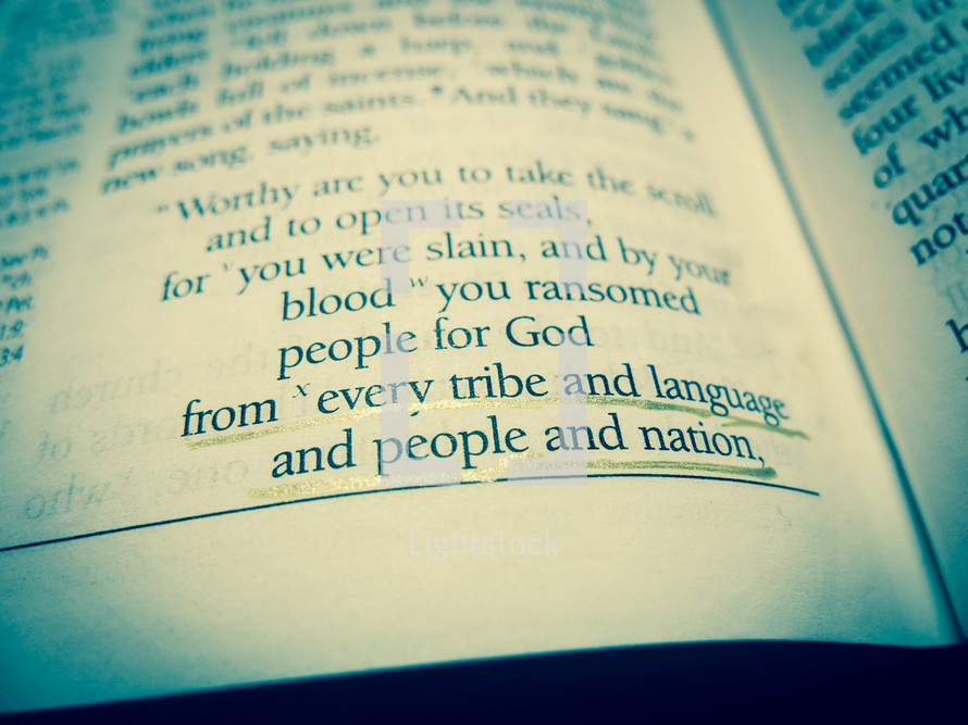 "A bible open at Revelation chapter 5 with the words ""from every tribe and language and people and nation"" underlined. Duo-tone."