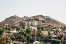 Hillside village of homes and marketplace in Cabo San Lucas.