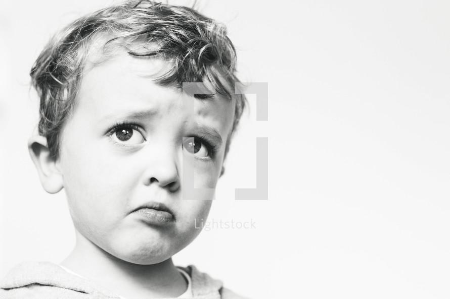 a pouting face of a toddler boy