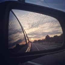 road view through a rearview mirror
