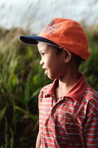 a boy in a ball cap
