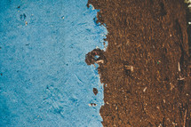 blue paint and dirt