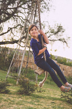 girl child on a rope swing