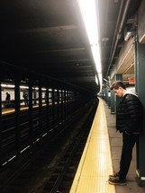man waiting in the subway