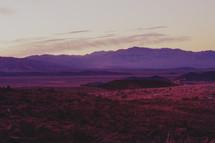 purple glow on a mountain at sunset