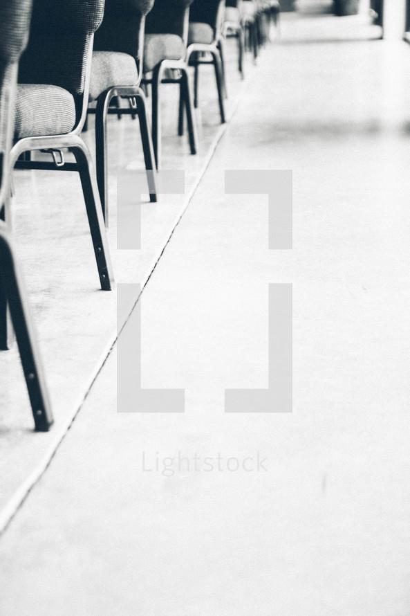 aisle floor beside of empty church chairs