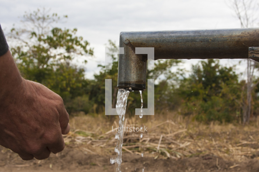 water pouring from an outdoor spigot
