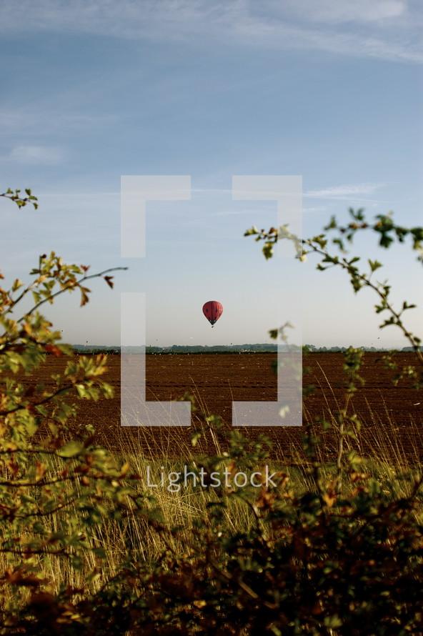 distant hot air balloon
