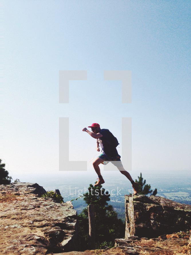 Man jumping over a cliff