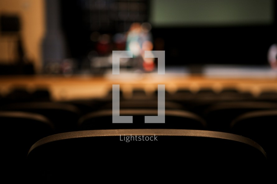 Empty seats facing a stage