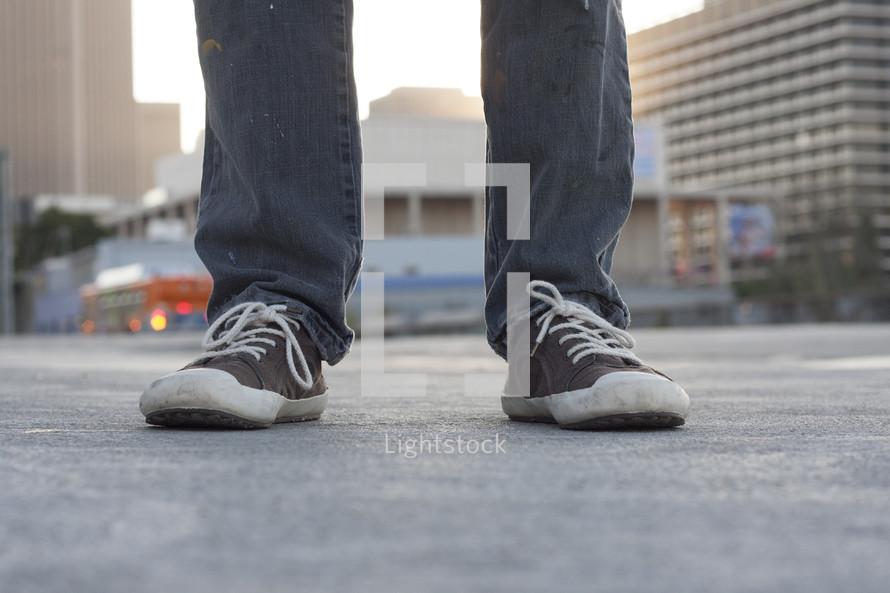 sneakers on a city sidewalk