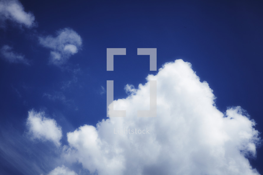 A billowing cloud in the blue sky