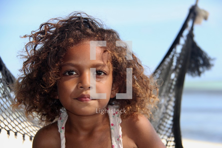 headshot of a young island girl