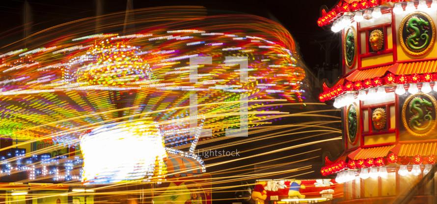 amusement park ride lights bokeh