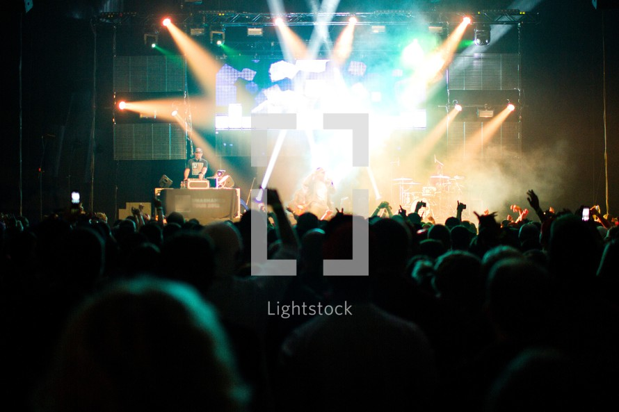 stage lights and silhouettes of audience members at a concert