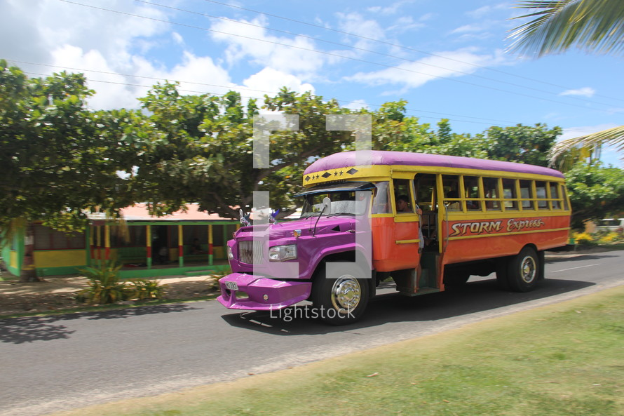 colorful tourbus on an island
