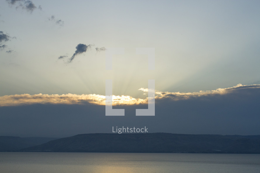 sunlight in the clouds over a sea