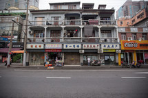 shops and apartments on a street in China