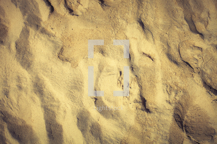 A fading footprint in the sand