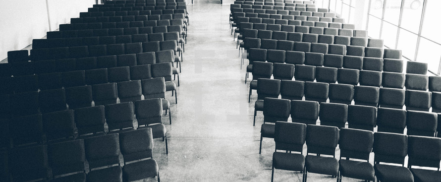 aisle between empty rows of chairs in church