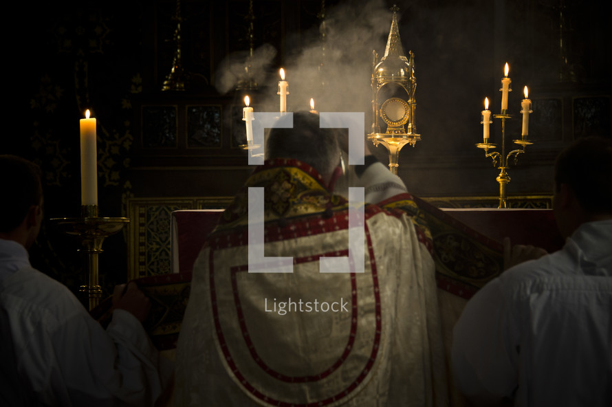 priest with incense
