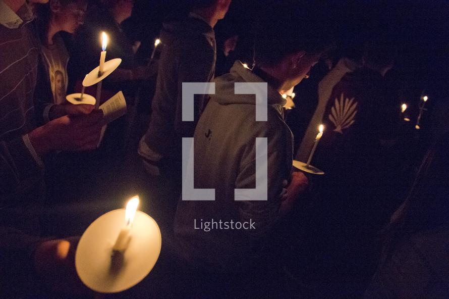holding candles at a prayer vigil