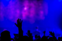Worship service hands raised blue silhouette