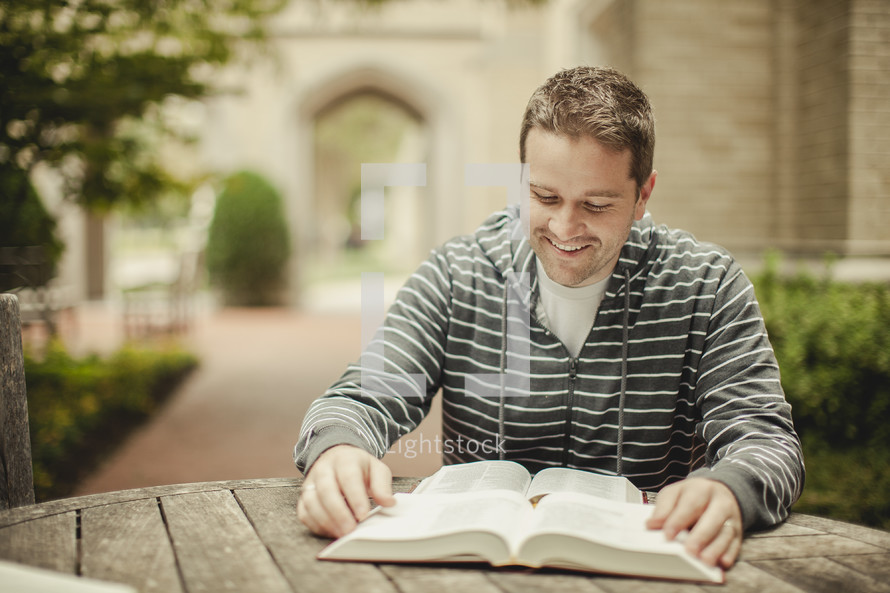 man reading from a bible