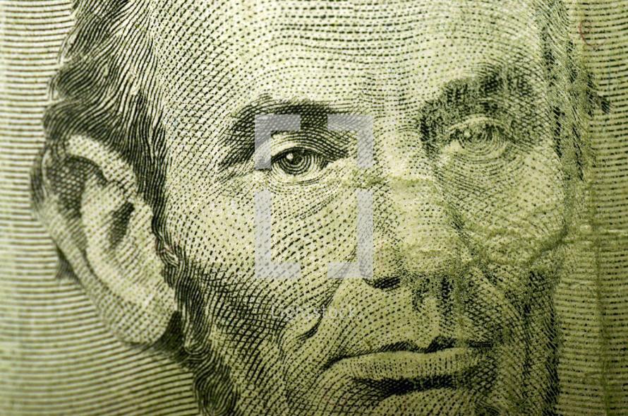 Abraham Lincoln on the 5 dollar bill