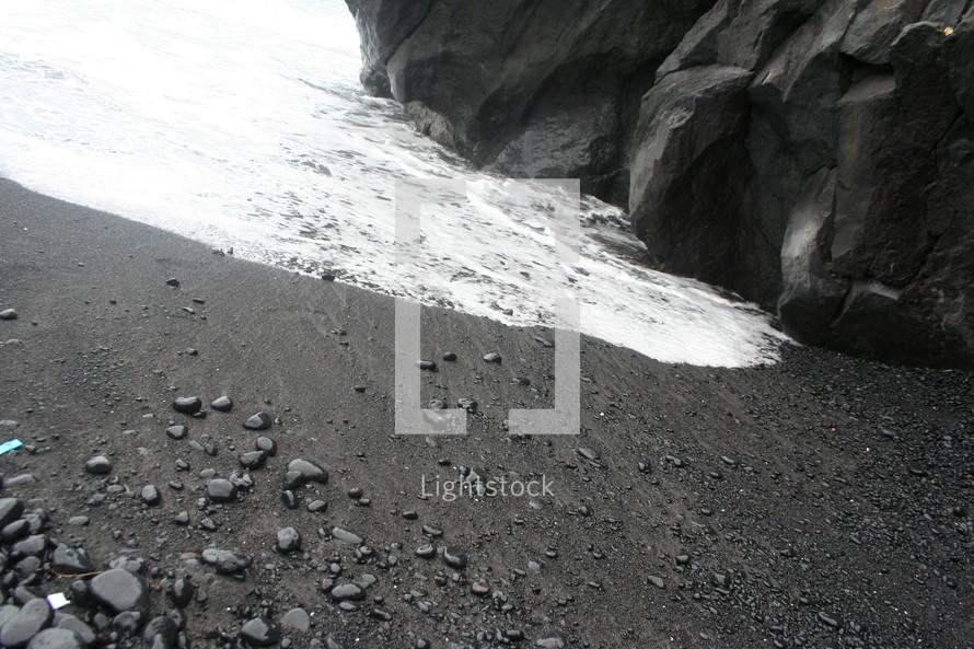tide washing onto a rocky beach