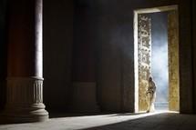 man entering the temple doors