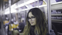woman on a subway train